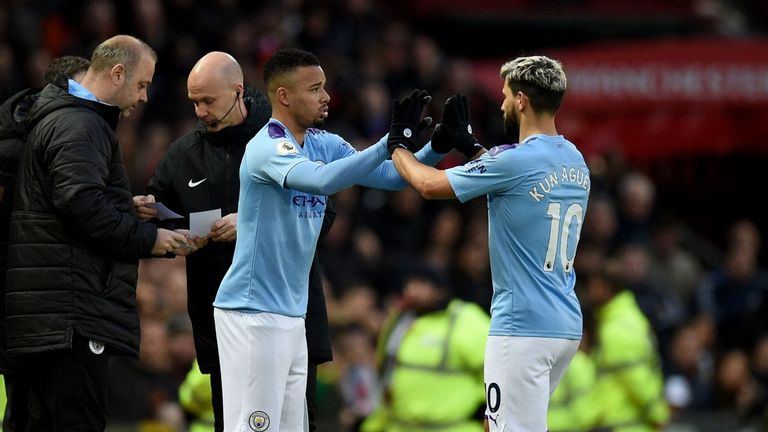Manchester City's Gabriel Jesus (L) replaces Sergio Aguero at Old Trafford in March