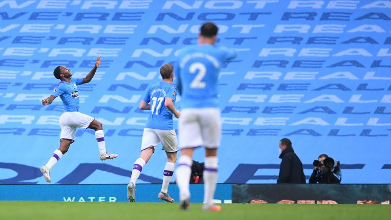 Raheem Sterling celebrates scoring in front of the empty Etihad terraces