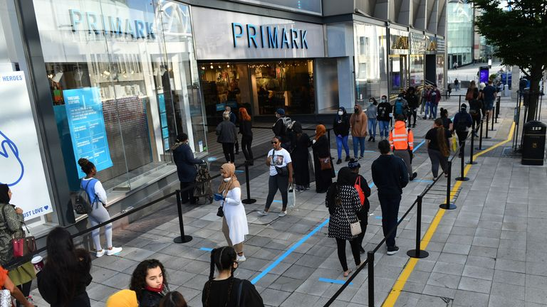 Shoppers wait line for the opening of Primark in Birmingham