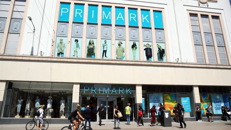 Members of the public queue outside a branch of Primark in Brighton