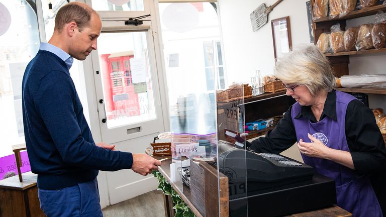 EMBARGOED to 1300 BST Friday June 19, 2020. The Duke of Cambridge uses contactless payment to pay owner Teresa Brandon for his purchases during a visit to Smiths the Bakers, in the High Street in King's Lynn, Norfolk.