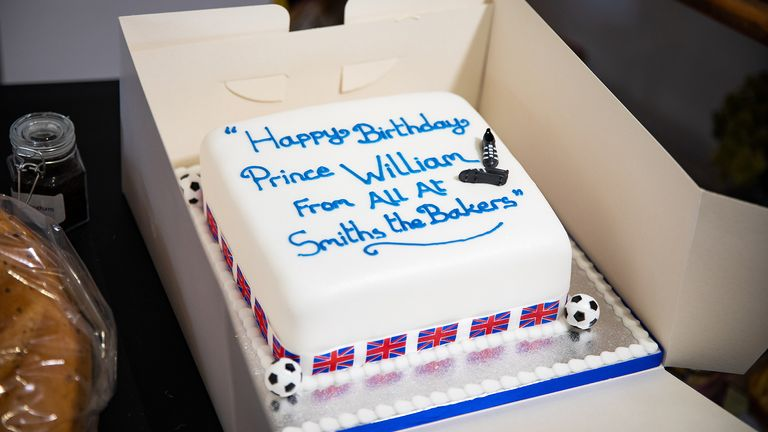 EMBARGOED to 1300 BST Friday June 19, 2020. The Duke of Cambridge is presented with a birthday cake by shop owner Paul Brandon during a visit to Smiths the Bakers, in the High Street in King's Lynn, Norfolk.