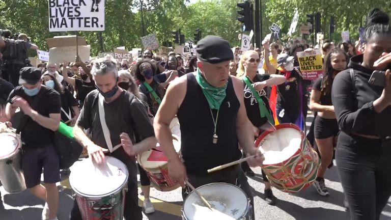 Black Lives Matter protesters beat drums as they march to Westminster