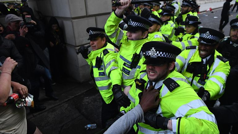 Police clashed with protesters at King Charles Street archway in central London