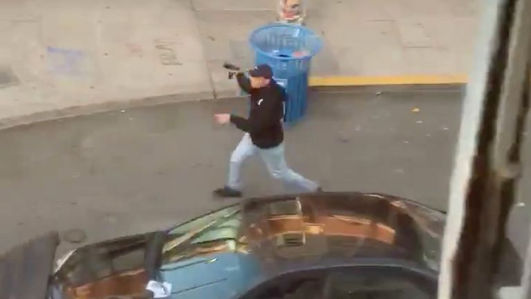 The person appears to be brandishing a gun