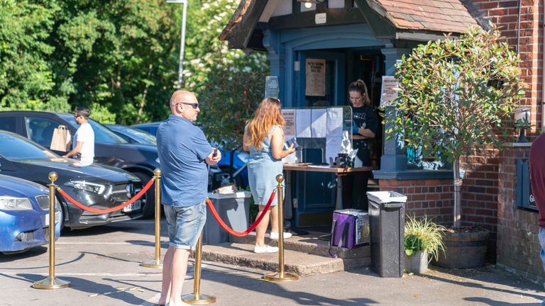 Customers may have to queue before entering a pub