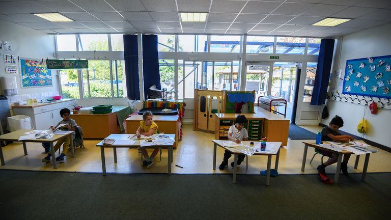 Pupils sit at separate desks at Hiltingbury Infant School in Hampshire