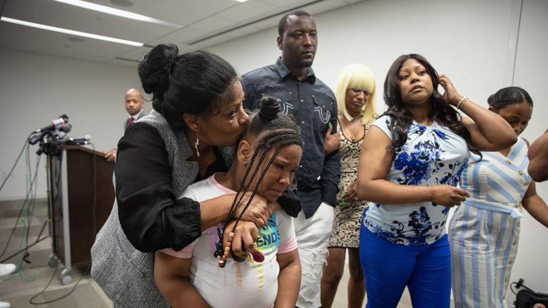 Rayshard Brooks's daughter Blessing, eight, leaves the press conference in tears