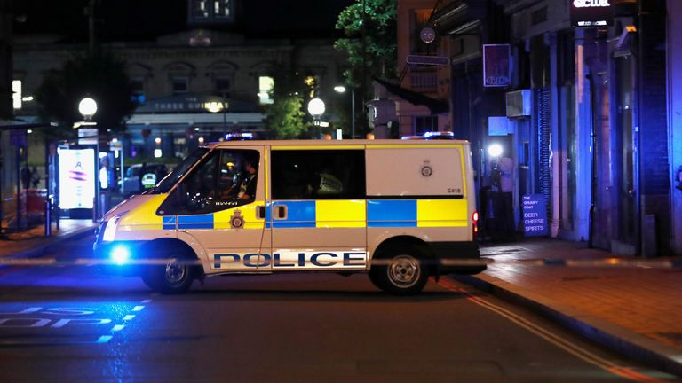 A police van is seen with cordon tape at the scene of reported multiple stabbings in Reading, Britain, June 20, 2020. REUTERS/Peter Cziborra