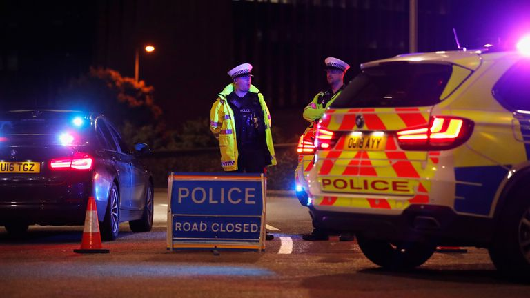 Police officers and their vehicles close off a road after reported multiple stabbings in Reading, Britain, June 20, 2020. REUTERS/Peter Cziborra