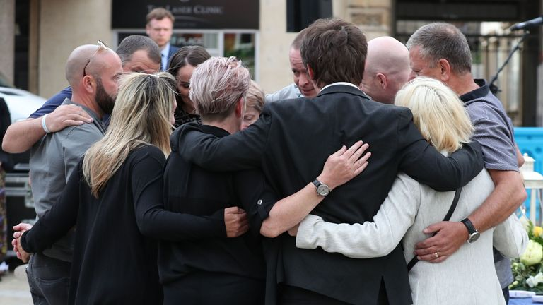 Family members of the three victims comfort each other after lighting candles during a vigil at Market Place, Reading, in memory of David Wails, Joseph Ritchie-Bennett and James Furlong, who were killed in the Reading terror attack in Forbury Gardens in the town centre, shortly before 7pm on June 20. PA Photo. Picture date: Saturday June 27, 2020. See PA story POLICE Reading. Photo credit should read: Steve Parsons/PA Wire