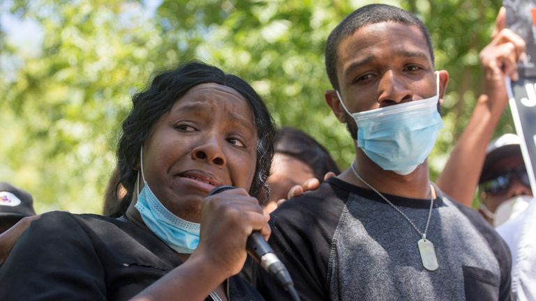 Robert Fuller's sister Diamond Alexander and her husband Jose join a protest rally