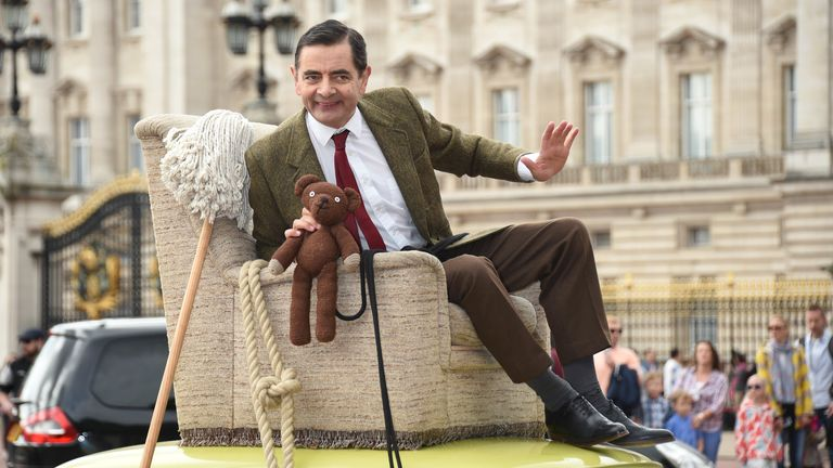 Rowan Atkinson in character as Mr Bean outside Buckingham Palace