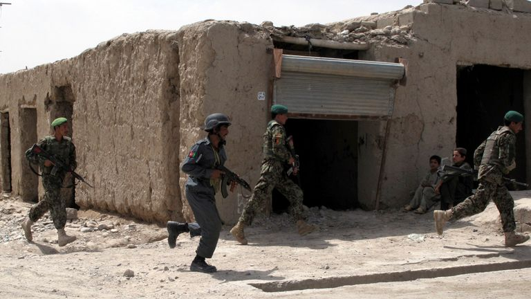 FILE PIC: Afghan police soldiers maintain security during a visit to Sangin district by Helmand's governor