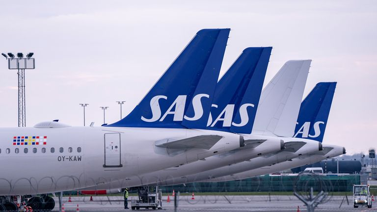Scandinavian Airlines (SAS) Airbus A320 planes are parked at Copenhagen airport in Kastrup, Denmark, March 15, 2020
