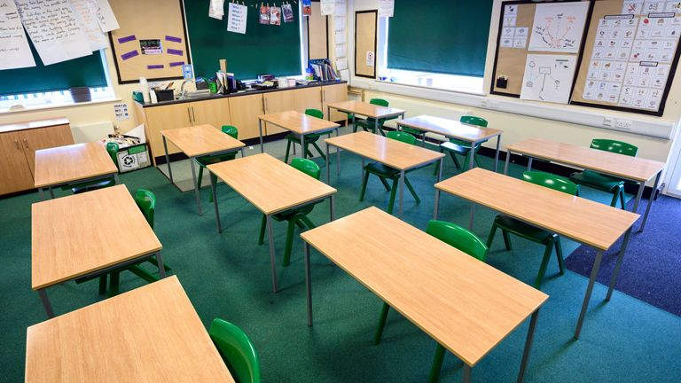 A classroom is set out with socially distanced seating