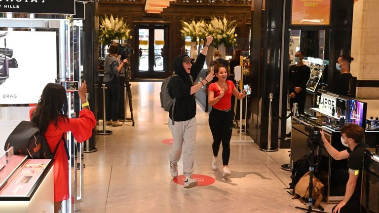The first customers react as they are filmed entering Selfridges department store