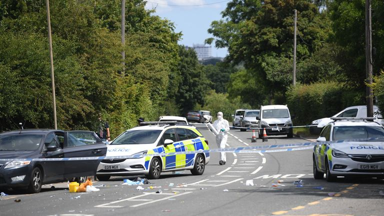 Forensic officers at the scene of the shooting in Roydon, Harlow