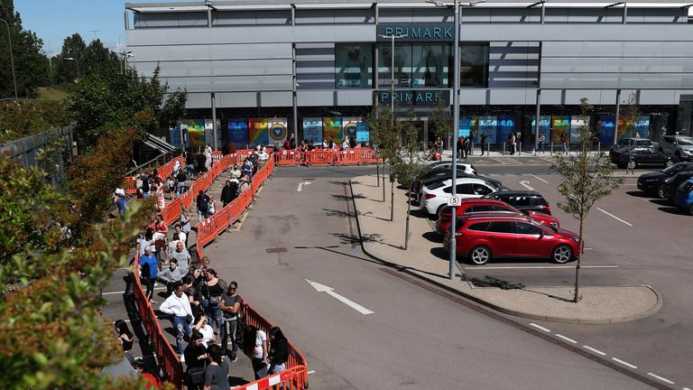 Shoppers queue outside Primark at the MK1 Shopping Park in Milton Keynes