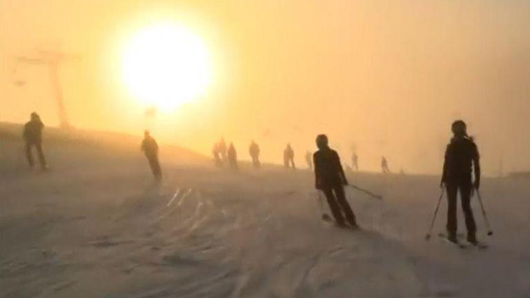 Skiers celebrate midsummer midnight in Sweden