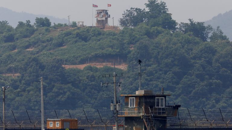 A North Korean soldier could be seen standing guard at his post (in the distance) near the demilitarised zone