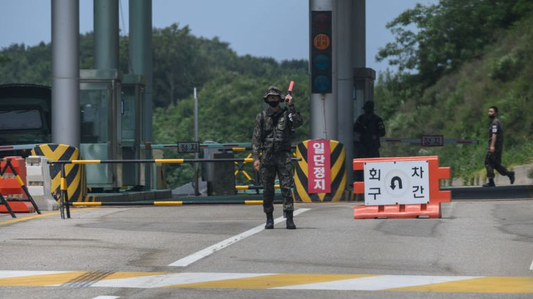 A guard stands at a checkpoint in the South leading to the Kamgung Mountain Resort in the North where troops are being deployed