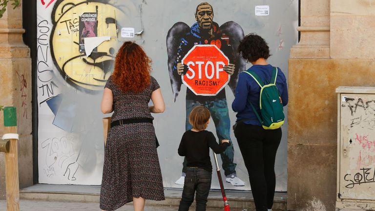 A street poster artwork by Italian urban artist Salvatore Benintende aka 'TVBOY' depicting George Floyd with angel wings in a street in Barcelona