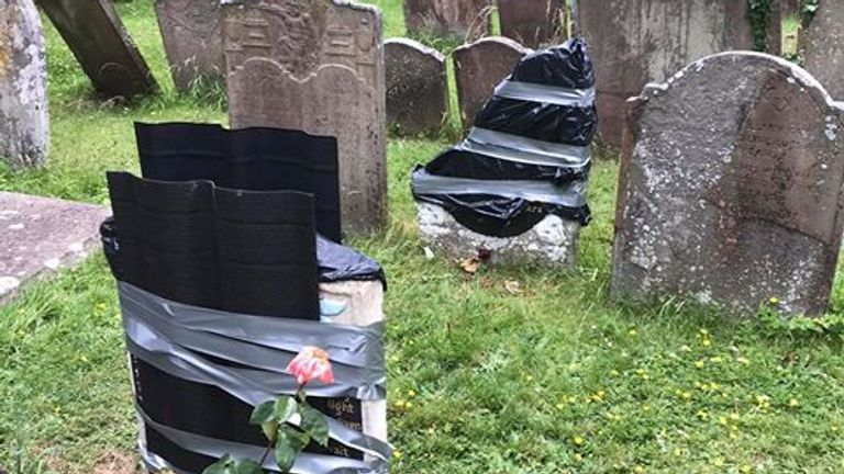 The headstones were wrapped up after the vandalism. Pic: Mark Weston