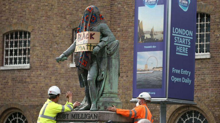 A statue of slave owner Robert Milligan at West India Quay, east London, has been removed
