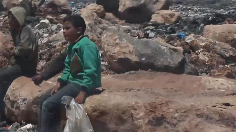 Syrian children scavenge through dumpsters in the desperate hope to find food
