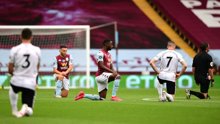 Aston Villa and Sheffield United are joined by the referee in taking a knee in support of the Black Lives Matter movement