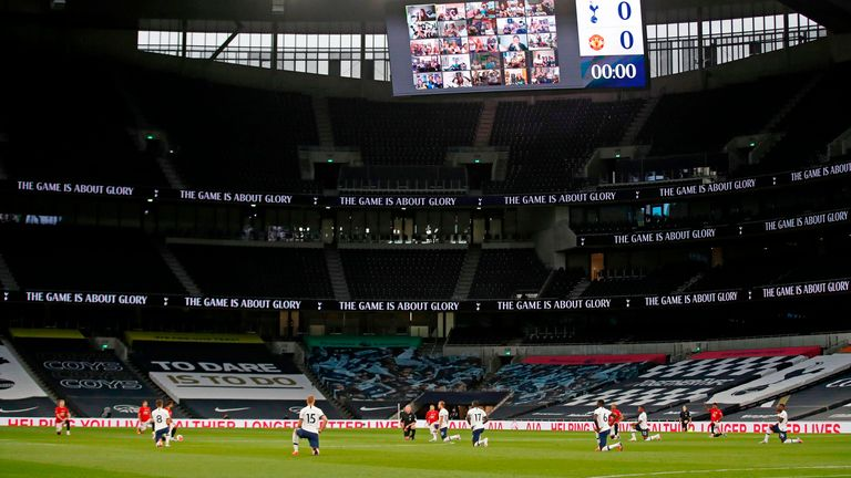 Players take a knee at the beginning of the game between Tottenham Hotspur and Manchester United