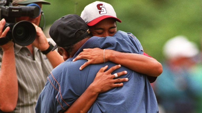 27 Aug 1995: Tiger Woods shares a moment with his father, Earl, as they embrace on the final hole after Tiger''s victory in the1995 U.S. Amatuer Championships held at the Newport Country Club in Newport, Rhode Island. Mandatory Credit: J.D. Cuban