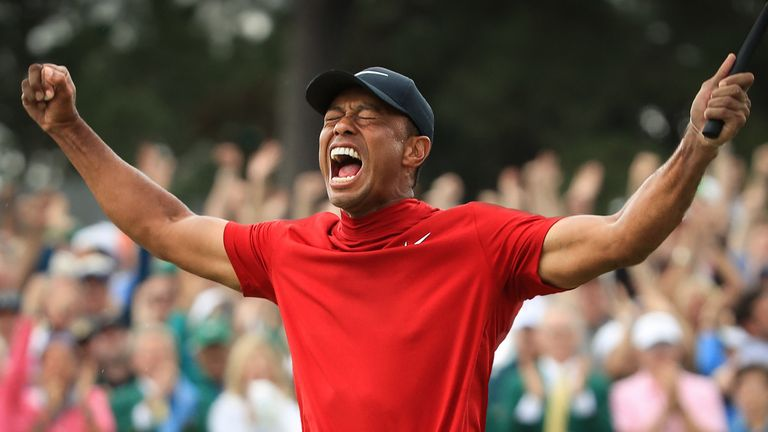 AUGUSTA, GEORGIA - APRIL 14: Tiger Woods (L) of the United States celebrates on the 18th green after winning the Masters at Augusta National Golf Club on April 14, 2019 in Augusta, Georgia. (Photo by Andrew Redington/Getty Images)
