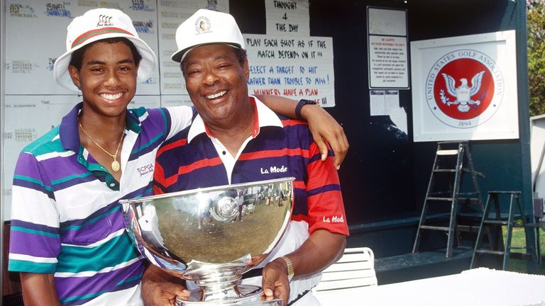 ORLANDO, FL - JULY 28, 1991: Tiger Woods, age 15 years, six months, and 28 days, and father Earl Woods, pose for a photo while celebrating Tiger's victory at the 1991 USGA Junior Amateur Championships on July 28, 1991 at the Bay Hill Club in Orlando, Florida. (Photo by Rick Dole/Getty Images)