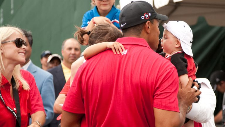BETHESDA, MD - JULY 05: Tiger Woods greets his children Sam Woods and Charlie Woods after the final round of the 2009 AT&T National hosted by Tiger Woods, held at Congressional Country Club onSunday, July 5, 2009 in Bethesda, Maryland. (Photo by Darren Carroll/Getty Images) *** Local Caption *** Elin Woods;Sam Woods;Tiger Woods;Charlie Woods