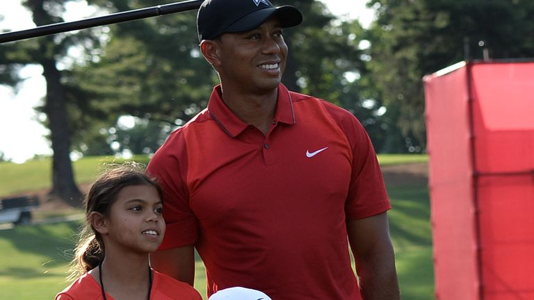 Tiger Woods stands with his children Sam(L) and Charlie after the Quicken Loans National at Congressional Country Club in Bethesda, Maryland on June 26, 2016. / AFP / ANDREW CABALLERO-REYNOLDS (Photo credit should read ANDREW CABALLERO-REYNOLDS/AFP via Getty Images)