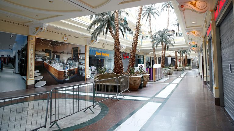 Barriers and shops are seen inside the Trafford Centre in Manchester