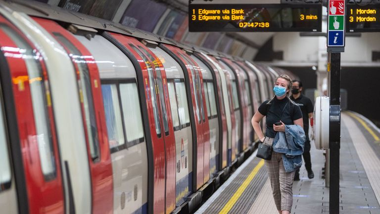 A commuter wearing a protective face mask at Clapham Common underground station