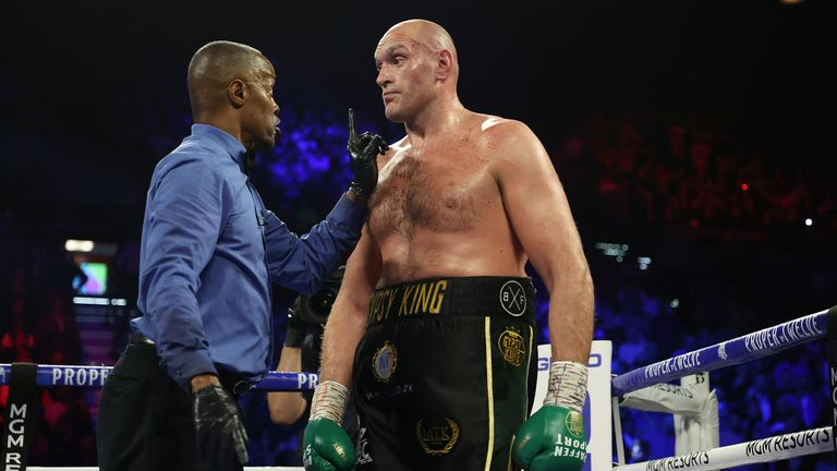 Tyson Fury is spoken to by the referee before his victory over Deontay Wilder