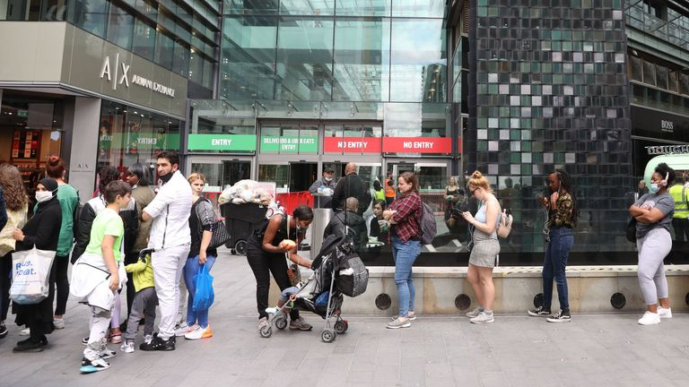 Shoppers queue to enter Westfield shopping centre in east London on June 20, 2020 on the first Saturday since non-essential retail stores were able to reopen from their coronavirus shutdown. (Photo by ISABEL INFANTES / AFP) (Photo by ISABEL INFANTES/AFP via Getty Images)