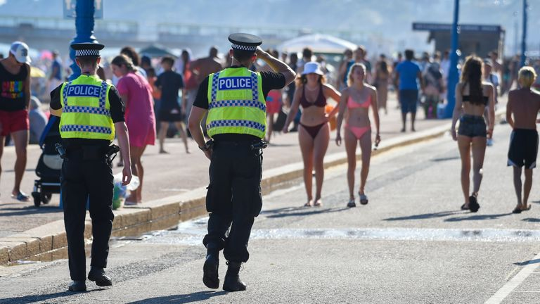 BOURNEMOUTH, ENGLAND - JUNE 25: Police patrol the beach on June 25, 2020 in Bournemouth, United Kingdom. A major incident was declared by the local council as thousands flocked to Bournemouth and the Dorset coast. The UK is experiencing a summer heatwave, with temperatures in many parts of the country expected to rise above 30C and weather warnings in place for thunderstorms at the end of the week. (Photo by Finnbarr Webster/Getty Images)