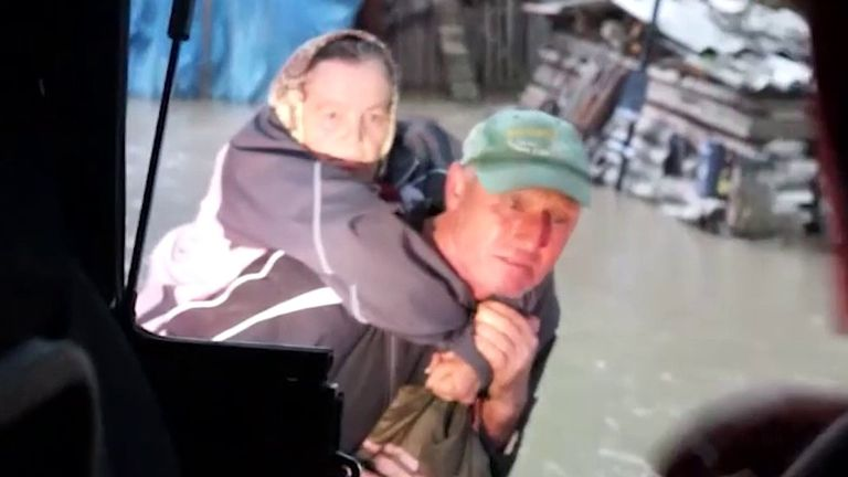 Elderly woman is rescued from extreme flood in Ukraine