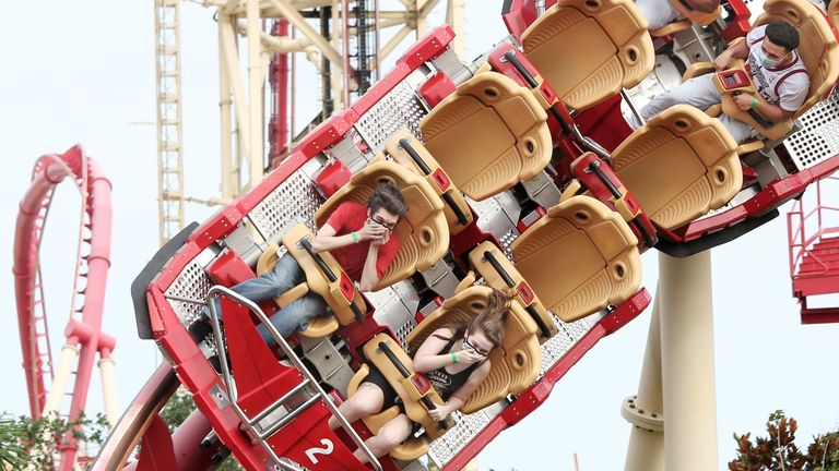 Visitors ride the Hollywood Rip Ride Rockit roller coaster at Universal Studios theme park on the first day of reopening from the coronavirus pandemic, on June 5, 2020, in Orlando, Florida. (Photo by Gregg Newton / AFP) (Photo by GREGG NEWTON/AFP via Getty Images)