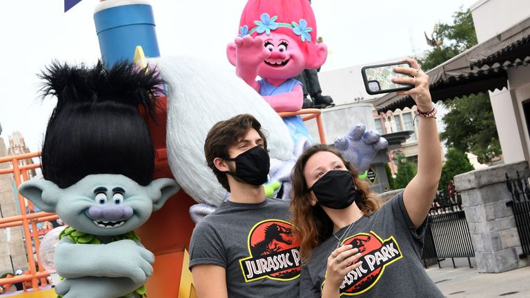 Visitors take a selfie at Universal Studios theme park on the first day of reopening from the coronavirus pandemic, on June 05, 2020 in Orlando, Florida. (Photo by Gerardo Mora/Getty Images,)