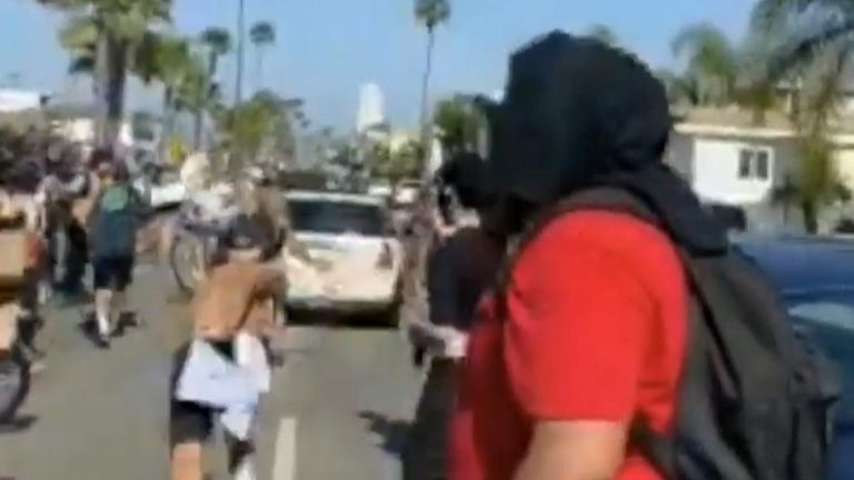 Newport Beach Protesters Scatter as Car Drives Through Group, Narrowly Missing Young Child