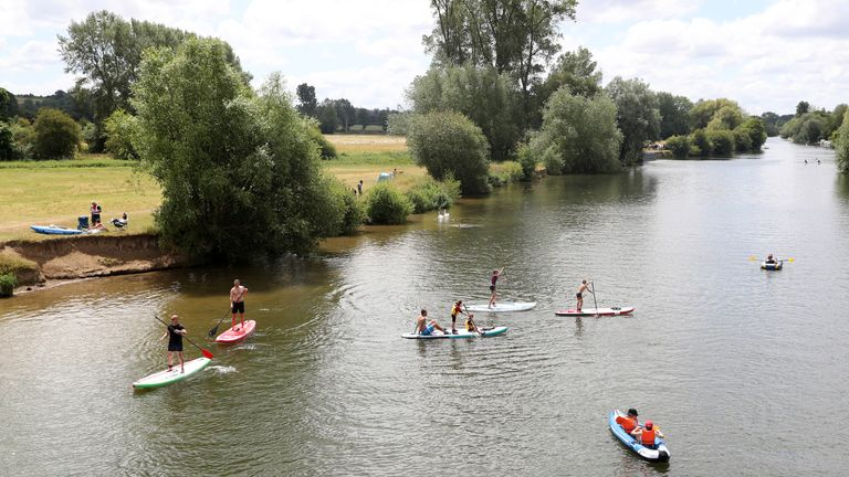 Members of the public Kayak and paddle board on the River Thames