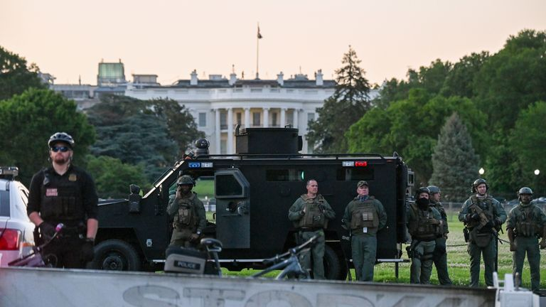 SWAT personnel protect the White House
