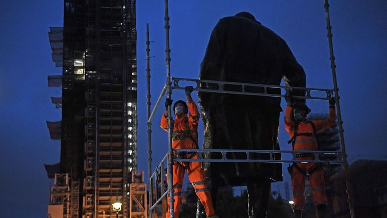 Scaffolders erect boarding around the statue of Sir Winston Churhill at Parliament Square, London,