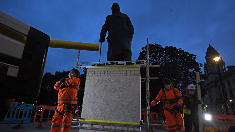 Scaffolders erect boarding around the statue of Sir Winston Churchill in Parliament Square, London